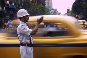 A constable traffic policeman directing taxis Calcutta Kolkata I